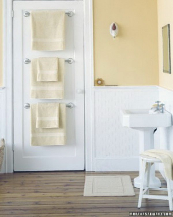 Hang Towel Holders Behind Bathroom Door For More Storage Space