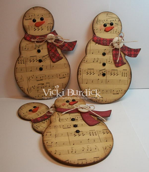 Rustic Snowmen Made Of Music Sheets.