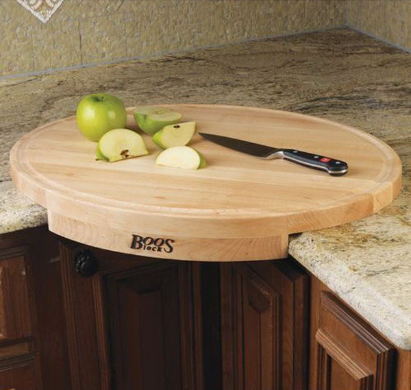 John Boos Corner Cutting Board. This oval-shaped maple wood cutting board converts a counter corner space into efficient working space. Get it at