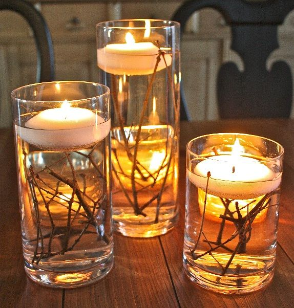 Floating Candle Centerpieces with Twigs.Dress up your table with a simple, easy, and inexpensive floating candle centerpiece! Tutorial via