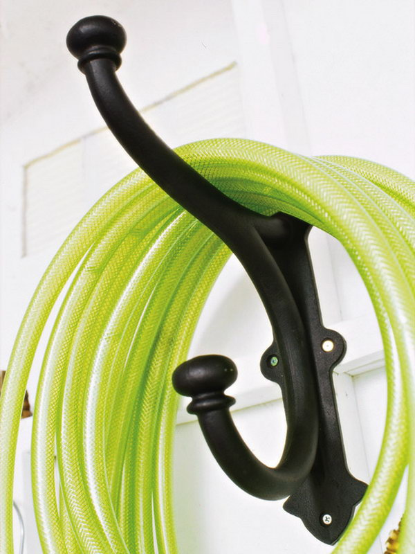 Store Your Garden Hose with Coat Hangers.