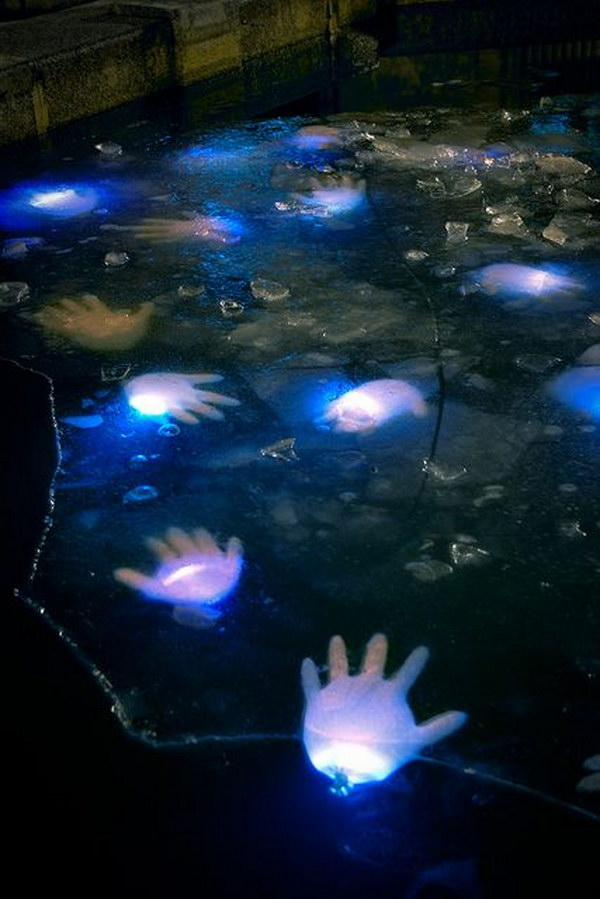 What a creepy idea for Halloween decor! Latex gloves with glow sticks in your pond for Halloween!