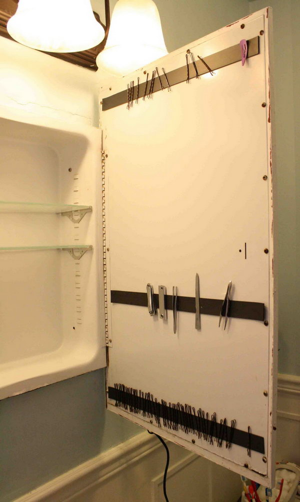 Use a magnetic strip to store bobby pins behind a cabinet door.