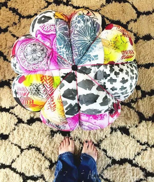 Colorful DIY Scrap Fabric Floor Pouf. Get the tutorial