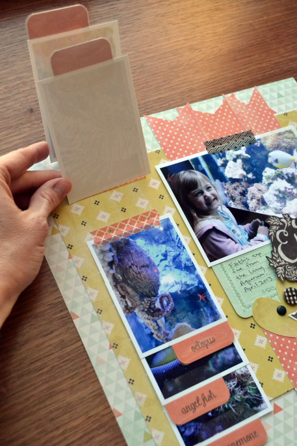 Scrapbooking with the Tab Punch. A really fun way to make your scrapbook with a tub. Save space and wow anyone who looks at it.