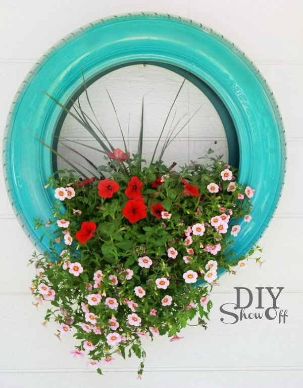 Hanging Tire Flower Planter. Get the tutorial