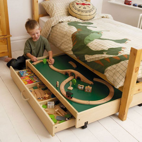 Play Table Under the Bed. This play table under the bed not only provides a useful play area in your busy bedroom, but also reveals more storage space for toys.
