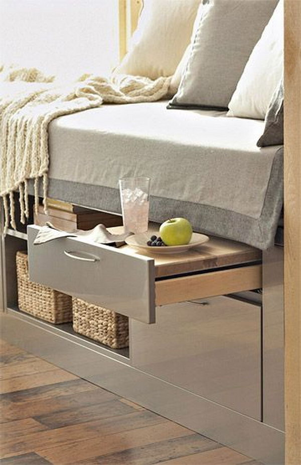 A Bed Incorporates Storage Units and a Pull Out Shelf table.
