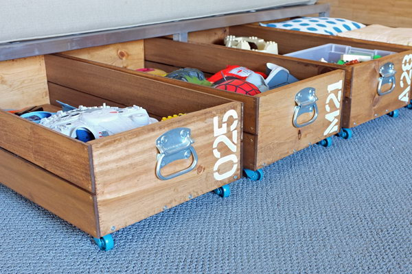 DIY Rolling Storage Crates. The crates were surprisingly easy to make and relatively inexpensive. They roll out on casters and maximize the storage space under the bed. Learn how to make these crates