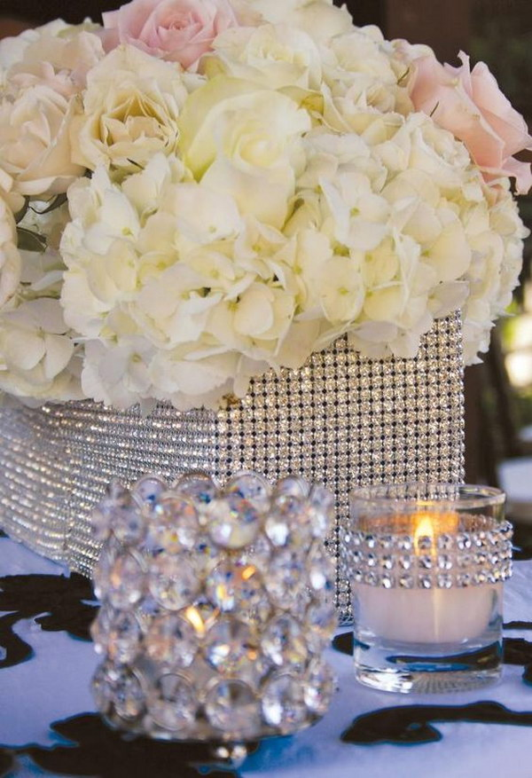 Diamond Mesh Wrapped Centerpieces. Buy rhinestones, glue them with a hot glue gun or gorilla glue and voila!