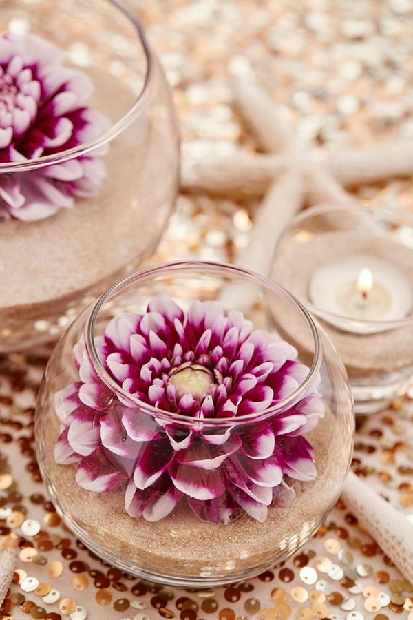 DIY Sand And Flowers Wedding Centerpieces.