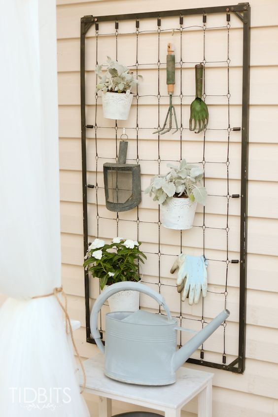 Repurposed Crib Garden Tool Hanger.